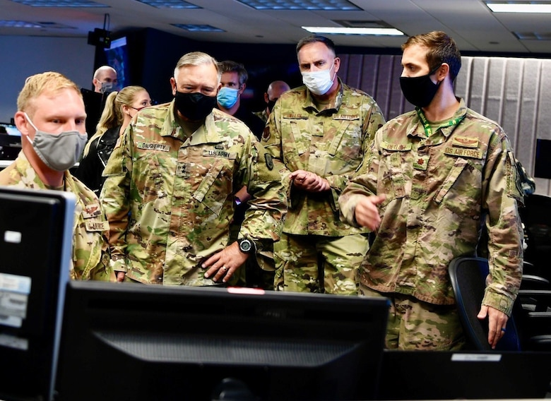 Army Maj. Gen. Bret Daugherty, center left, Washington National Guard adjutant general, and Air Force Brig. Gen. Gent Welsh, Washington Air National Guard commander, observe various software demonstrations of the Advanced Battle Management System at Joint Base Lewis-McChord, Wash., Sept. 2, 2020. The ABMS and the Army's Project Convergence will be combined as part of a new two-year agreement between both branches. (U.S. Army photo by Maj. Kimberly Burke)