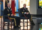 The 22nd Director of the Defense Intelligence Agency Lt. Gen. Scott Berrier (left) sits next to former DIA Director Lt. Gen. Robert Ashley Jr. during the change of change of directorship ceremony, Oct. 1, at DIA Headquarters.