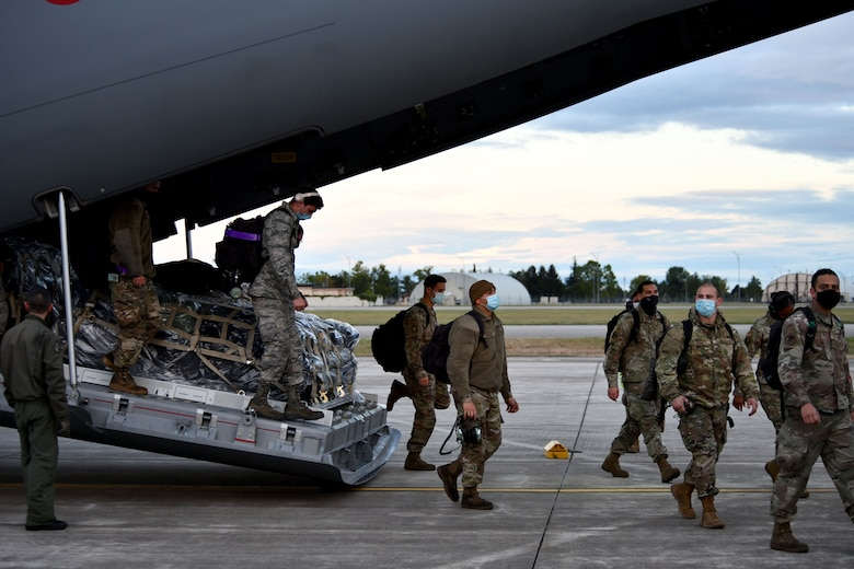 U.S. Airmen assigned to the 31st Aircraft Maintenance Squadron and 510th Fighter Squadron disembark from a Spanish air force Airbus A400M at Aviano Air Base, Italy, Sept. 28, 2020. The airmen returned from a four-week flying training deployment to Royal Air Force Lakenheath, United Kingdom. (U.S. Air Force photo by Staff Sgt. K. Tucker Owen)