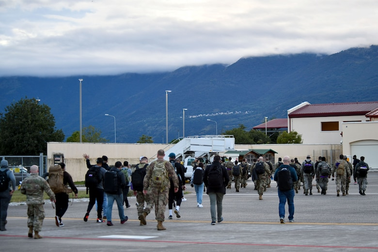 U.S. Airmen meet their families upon returning home from a flying training deployment (FTD) to Royal Air Force Lakenheath, United Kingdom, at Aviano Air Base, Italy, Sept. 28, 2020. The four-week long FTD was the largest personnel movement from Aviano since the onset of COVID-19. (U.S. Air Force photo by Staff Sgt. K. Tucker Owen)