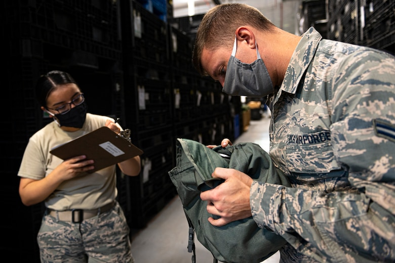 A photo of an Airman reading a serial number