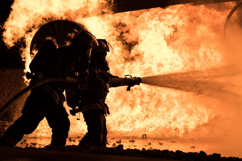 Airmen extinguish live fire during exercise