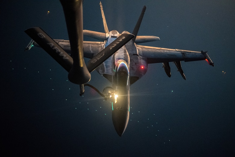 U.S. Navy F/A-18E Super Hornet is refueled by U.S. Air Force KC-135