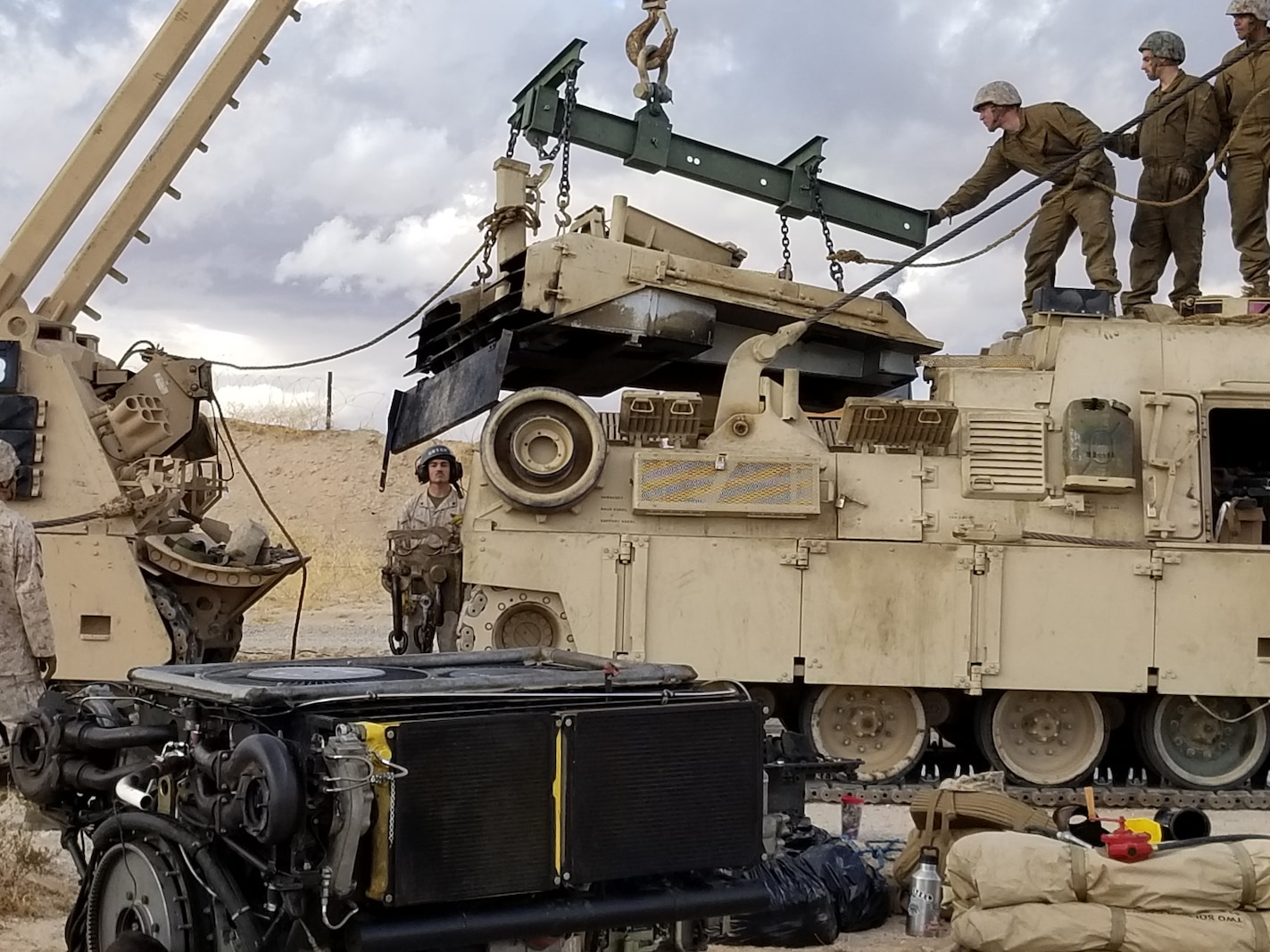 Marines with support Company, Combat Logistics Battalion 7, 1st Marine Logistics Group, work to remove the deck plate in order to replace the powerpack during Exercise Steel Knight 2019 at Marine Corps Base Camp Pendleton, California, Dec. 8, 2019.
