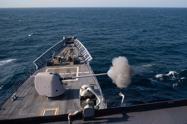 ARABIAN GULF (Sept. 28, 2020) - The guided-missile cruiser USS Princeton (CG 59) fires its Mark 45 5-inch gun during a live-fire exercise in the Arabian Gulf, Sept. 28. Princeton is part of the Nimitz Carrier Strike Group and is deployed to the U.S. 5th Fleet area of operations to ensure maritime stability and security in the Central Region, connecting the Mediterranean and Pacific through the Western Indian Ocean and three critical chokepoints to the free flow of global commerce. (U.S. Navy photo by Mass Communication Specialist 2nd Class Logan C. Kellums)