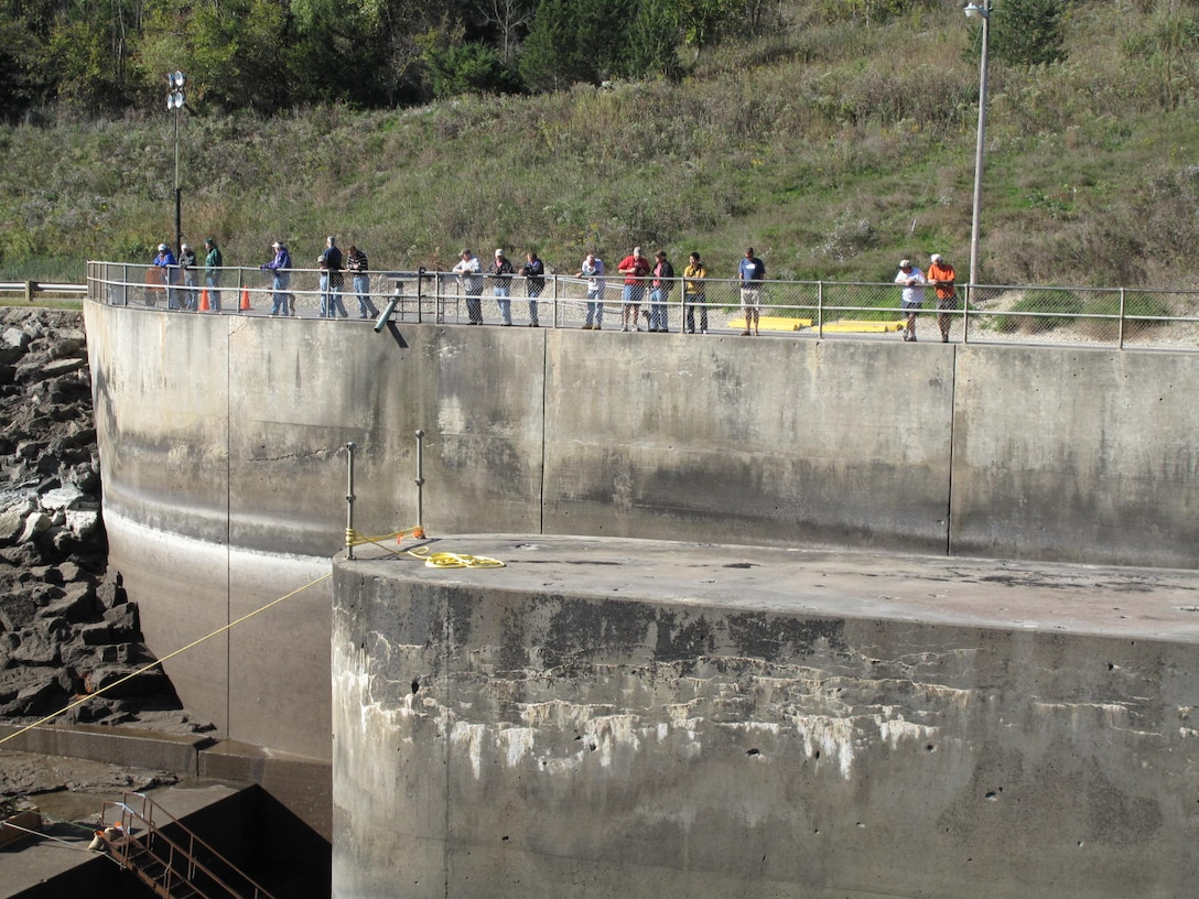 Visitors view the dewatered stilling basin during the periodic inspection in 2015.  Unlike previous inspections, the public will be prohibited from accessing the basin area due to ongoing construction.