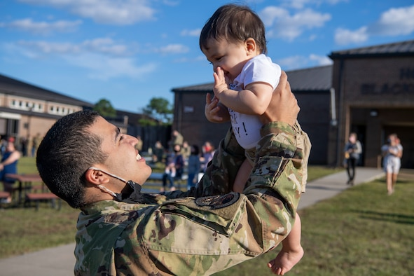 An Airman reunites with his family upon returning from a deployment.