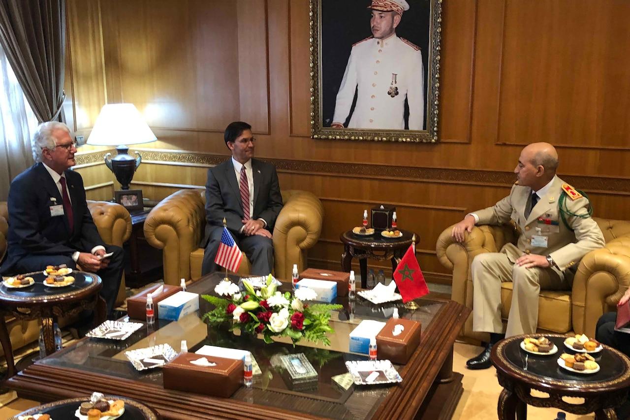 Men sit in office.