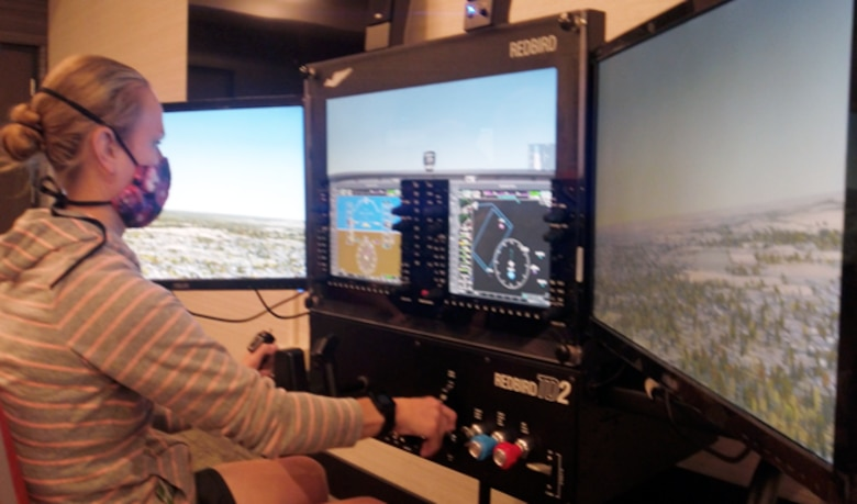 Capt. Kayla Pipe practices on a Civil Air Patrol flight simulator. CAP is one of the four partners in the Air Force Total Force. Consisting of CAP as the Air Force auxiliary as well as the Air National Guard, Air Force Reserve and active-duty Air Force, each partner has specific missions that often foster collaboration. (U.S. Air Force courtesy photo)