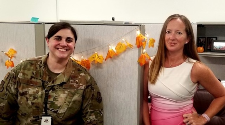 PM Maj. Jensen and CO Dana Alexander at Eglin AFB take a moment to relax during a busy workday.