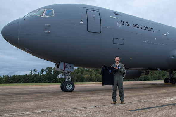 Second Lt. Alisson Moraes, 14th Student Squadron undergraduate pilot training graduate, poses with a 344th Air Refueling Squadron t-shirt in front of a KC-46A Pegasus Sept. 25, 2020 at Columbus Air Force Base, Mississippi. Moraes received the KC-46 as his future aircraft assignment, which became his number one choice after touring the aircraft for the first time in 2019. (U.S. Air Force photo by Senior Airman Skyler Combs)