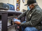 Charlie Turner, 12th Training Squadron electronic flight bag hardware manager, loads EFB devices into a charging station as he prepares for a software update Oct. 1, 2020, at Joint Base San Antonio-Randolph.