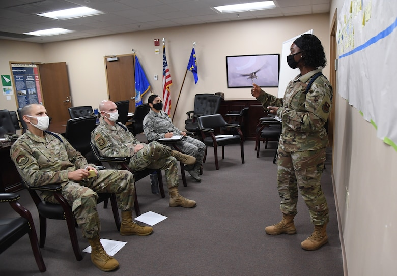U.S. Air Force Tech. Sgt. Shandresha Mitchell, 335th Training Squadron military training leader, briefs attendees during the Continuous Process Improvement workshop inside Matero Hall at Keesler Air Force Base, Mississippi, October 1, 2020. The workshop included 81st Training Group military training instructors discussing ways of improvement for current procedures being followed by focusing on maximizing value, minimizing waste, sharing best practices and standardizing across the 81st TRG whenever and where ever possible. (U.S. Air Force photo by Kemberly Groue)