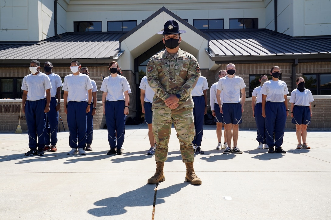 U.S. Air Force Tech. Sgt. Marcos Garcia, 37th Training Wing Detachment 5 military training instructor, and 81st Training Group students pose outside Erwin Manor at Keesler Air Force Base, Mississippi, Oct. 1, 2020. Garcia showcases the need for diversity by encouraging those he supervises to embrace the cultures of others in the military to help make a stronger Air Force. (U.S. Air Force photo bus Airman 1st Class Seth Haddix)