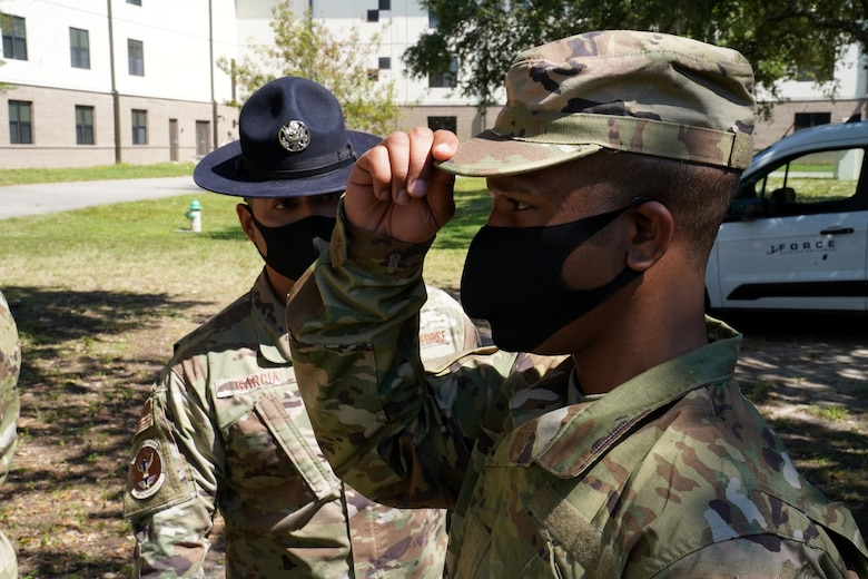 U.S. Air Force Tech. Sgt. Marcos Garcia, 37th Training Wing Detachment 5 military training instructor, confronts a basic military training trainee outside Erwin Manor at Keesler Air Force Base, Mississippi, Oct. 1, 2020. Garcia showcases the need for diversity by encouraging those he supervises to embrace the cultures of others in the military to help make a stronger Air Force. (U.S. Air Force photo bus Airman 1st Class Seth Haddix)