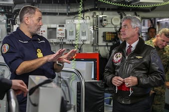 The Honorable Kenneth Braithwaite, Secretary of the Navy, receives an update from Commodore Steve Moorhouse, Commander United Kingdom Carrier Strike Group, while visiting Her Majesty's Ship Queen Elizabeth at sea off the coast of Flamborough, United Kingdom.