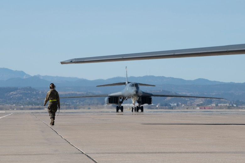 Two B-1B Lancers taxi on the runway at Ellsworth Air Force Base, S.D., after completing a Bomber Task Force deployment, Oct. 1, 2020. Bomber Task Force missions provide a persistent bomber presence in the Indo-Pacific theater and around the globe. (U.S. Air Force photo by Airman 1st Class Christina Bennett)