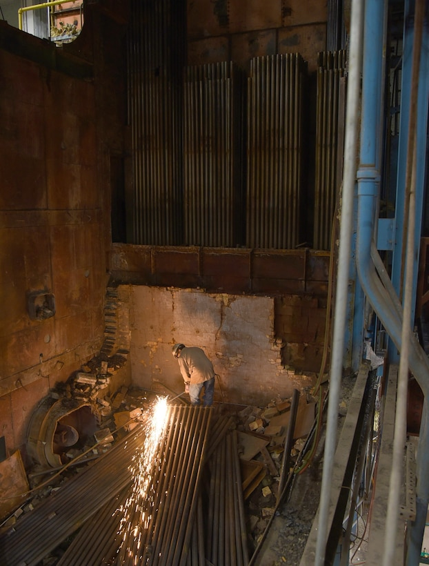A construction worker works in the demolition site of Boiler #1 in Bldg. 3001 on Tinker Air Force Base, Oklahoma.