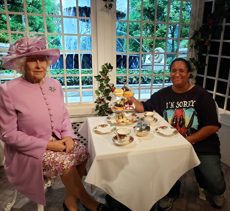 Candy Knight poses with a wax replica of Queen Elizabeth II at Madame Tussauds London. Knight is the Public Affairs Specialist for Headquarters Fourth Air Force at March Air Reserve Base, California. (Courtesy photo by Candy Knight)