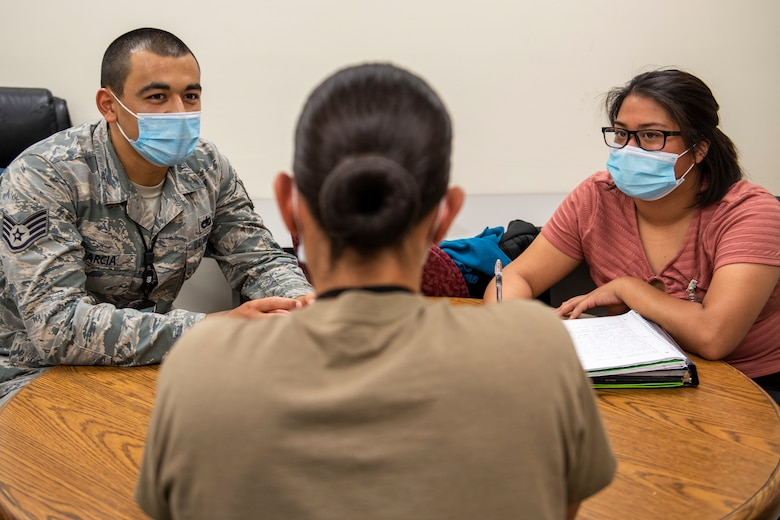 Staff Sgt. Raymond Garcia, left, and Senior Airman Jan Mariel Punelas, right, Leading for Innovation students, interview Airman 1st Class Alexandra Mendez, 7th Munitions Squadron armament weapons troop, at Dyess Air Force Base, Texas, Sept. 11, 2020.