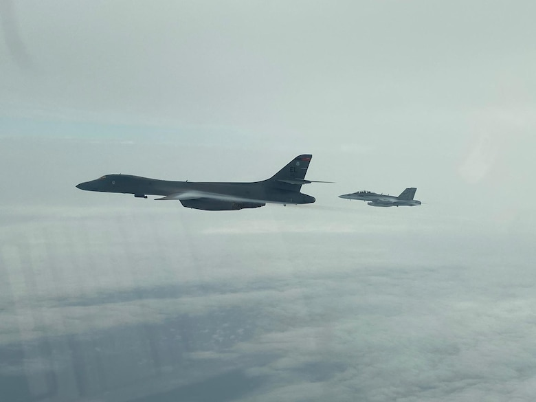 A B-1B Lancer from the 34th Expeditionary Bomb Squadron, Ellsworth Air Force Base, S.D., conducts integration training with a Koku-Jieitai, or Japanese Air Self-Defense Force (JASDF), F-15J in the Sea of Japan, Sept. 30, 2020. The B-1s integrated with Koku-Jietai to enhance bilateral interoperability and mutual readiness between the U.S. and Japan. (Courtesy photo)