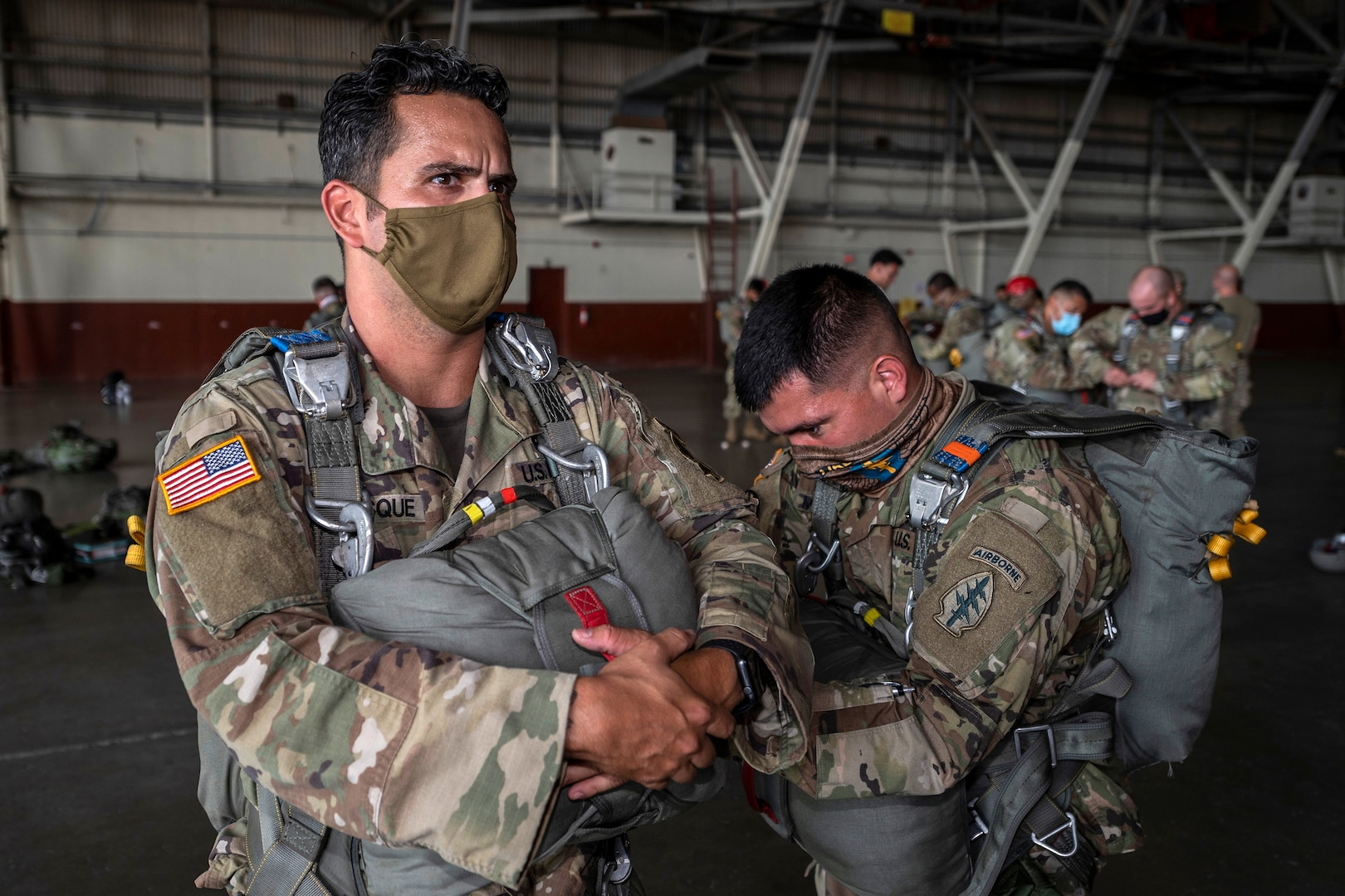 Soldiers prepare to parachute.