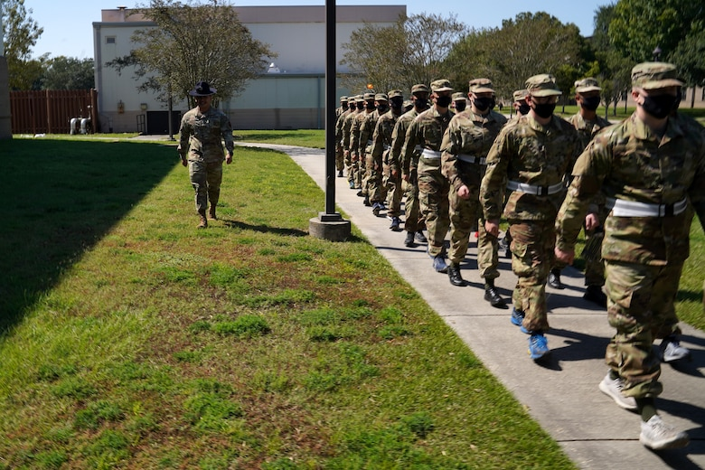 U.S. Air Force Tech. Sgt. Marcos Garcia, 37th Training Wing Detachment 5 military training instructor, marches basic military training trainees outside Erwin Manor at Keesler Air Force Base, Mississippi, Oct. 1, 2020. Garcia showcases the need for diversity by encouraging those he supervises to embrace the cultures of others in the military to help make a stronger Air Force. (U.S. Air Force photo bus Airman 1st Class Seth Haddix)