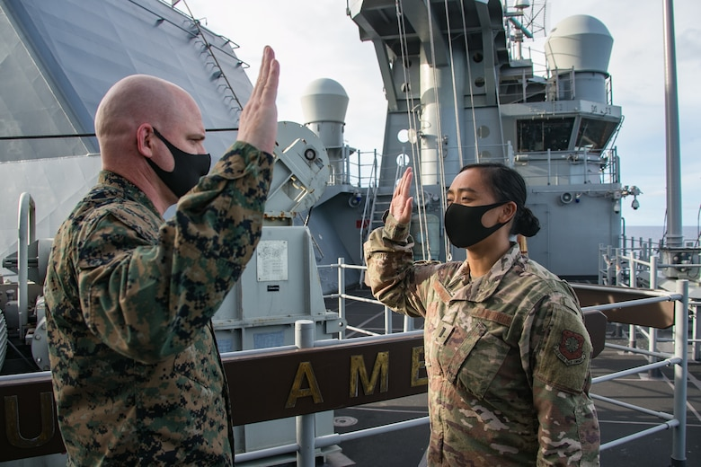 PHILIPPINE SEA (Sept. 17, 2020) 1st Lt. Rio Sarmiento, assigned to the 16th Space Control Squadron (SPCS), was administered the oath of office into the United States Space Force by U.S. Marine Col. Michael Nakonieczny, commanding officer of the 31st MEU, aboard amphibious assault ship USS America (LHA 6). Sarmiento was transferred from being an Air Force Space Operations Officer to becoming the first Space Force Liaison Officer (LNO) deployed with the 31st MEU. America, flagship of the America Expeditionary Strike Group, 31st MEU team, is operating in the U.S. 7th fleet area of operations to enhance interoperability with allies and partners and serve as a ready response force to defend peace and stability in the Indo-Pacific region. (U.S. Marine Corps photo by Lance Cpl. Brienna Tuck)