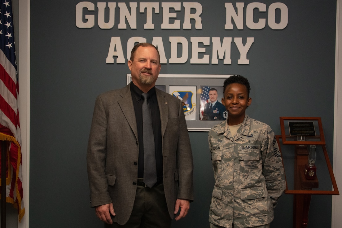 Toxie Robbins, former Gunter Noncommissioned Officer Academy commandant, poses for a photo beside Chief Master Sgt. Rosita Goodrum, the new commandant of Gunter NCOA