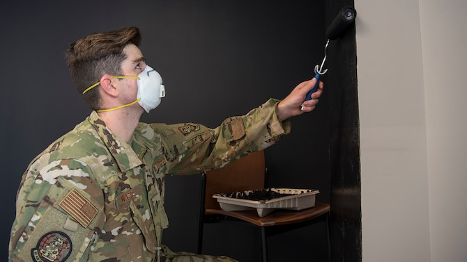 U.S. Air Force 2nd Lt. Charles Wasz, a 91st Air Refueling Squadron casual status pilot awaiting training, paints a wall in the 91st ARS heritage room at MacDill Air Force Base, Sept. 29, 2020.