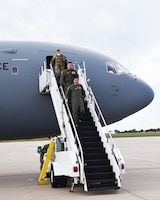 Lt.. Col. Eric Rivero, 905th Air Refueling Squadron commander, and Lt.. Col. Glenn Clark, 905th ARS director of operations, step out of a KC-46A Pegasus after their squadron's inaugural flight Oct. 3, 2020, at McConnell Air Force Base, Kan.  The 905th ARS is one of three Reserve air refueling squadrons here. The squadron reactivated at McConnell after a ten-year hiatus in May 2019