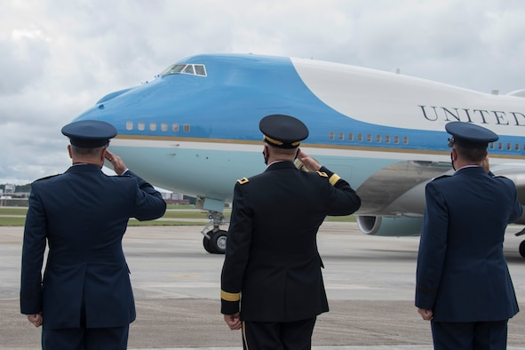 Col. Craig McPike, 94th Airlift Wing commander; Maj. Gen. Tom Carden, The Adjutant General of Georgia; and Maj. Gen. John Healy, 22nd Air Force commander, salute as Air Force One taxis at Dobbins Air Reserve Base, Ga., Sept. 25, 2020. The president arrived at Dobbins to attend a meeting at the Cobb Galleria. (U.S. Air Force photo/Andrew Park)