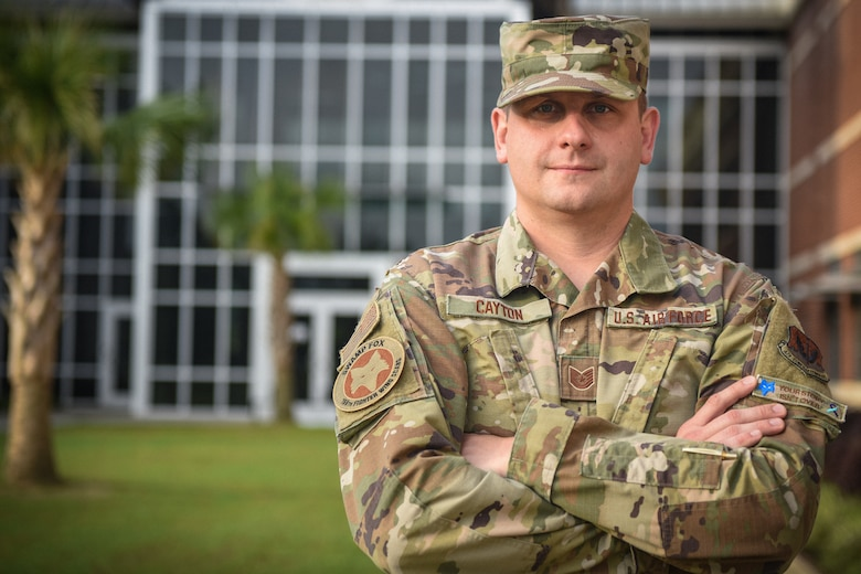 U.S. Air Force Tech. Sgt. Justin Cayton, a production recruiter for the 169th Fighter Wing, poses for a portrait in front of the Joint Armed Forces Reserve Center at McEntire Joint National Guard Base on August 18, 2020. Cayton is an Air National Guard recruiter charged with guiding potential recruits and applicants throughout their enlistment journey into the South Carolina Air National Guard. (U.S. Air National Guard photo by Senior Airman Mackenzie Bacalzo, 169th Fighter Wing Public Affairs)