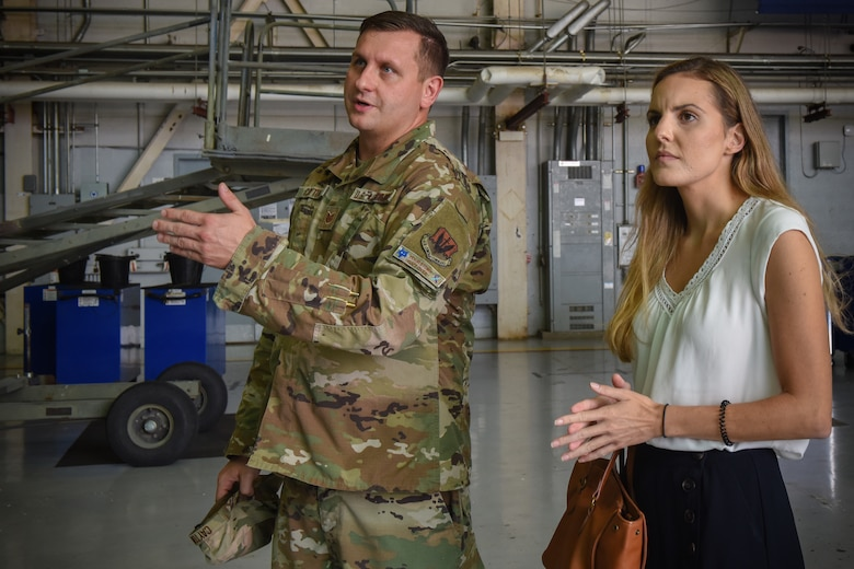 U.S. Air Force Tech. Sgt. Justin Cayton, a production recruiter for the 169th Fighter Wing, speaks to Ashley Spivey, a potential recruit, and provides a tour of the South Carolina Air National Guard at McEntire Joint National Guard Base on August 17, 2020. Cayton utilizes base tours in order to educate potential applicants on opportunities within the South Carolina Air National Guard.  (U.S. Air National Guard photo by Senior Airman Mackenzie Bacalzo, 169th Fighter Wing Public Affairs)