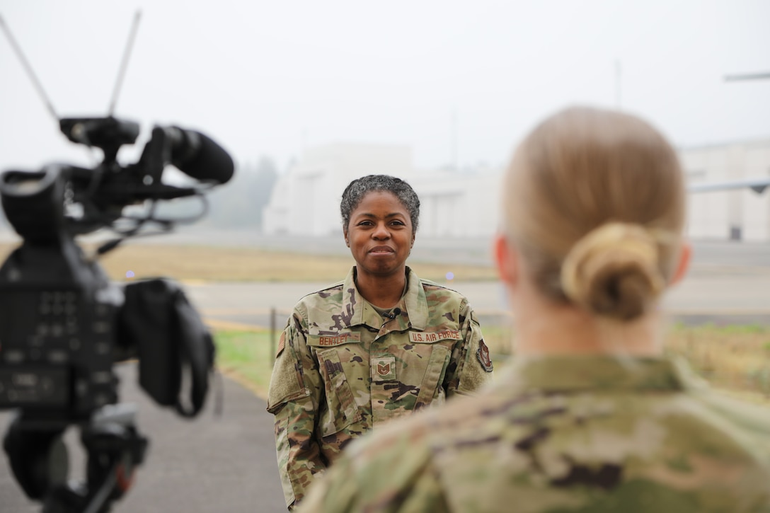 A Reserve Citizen Airman films a thank you video to her civilian employer on the flight line.