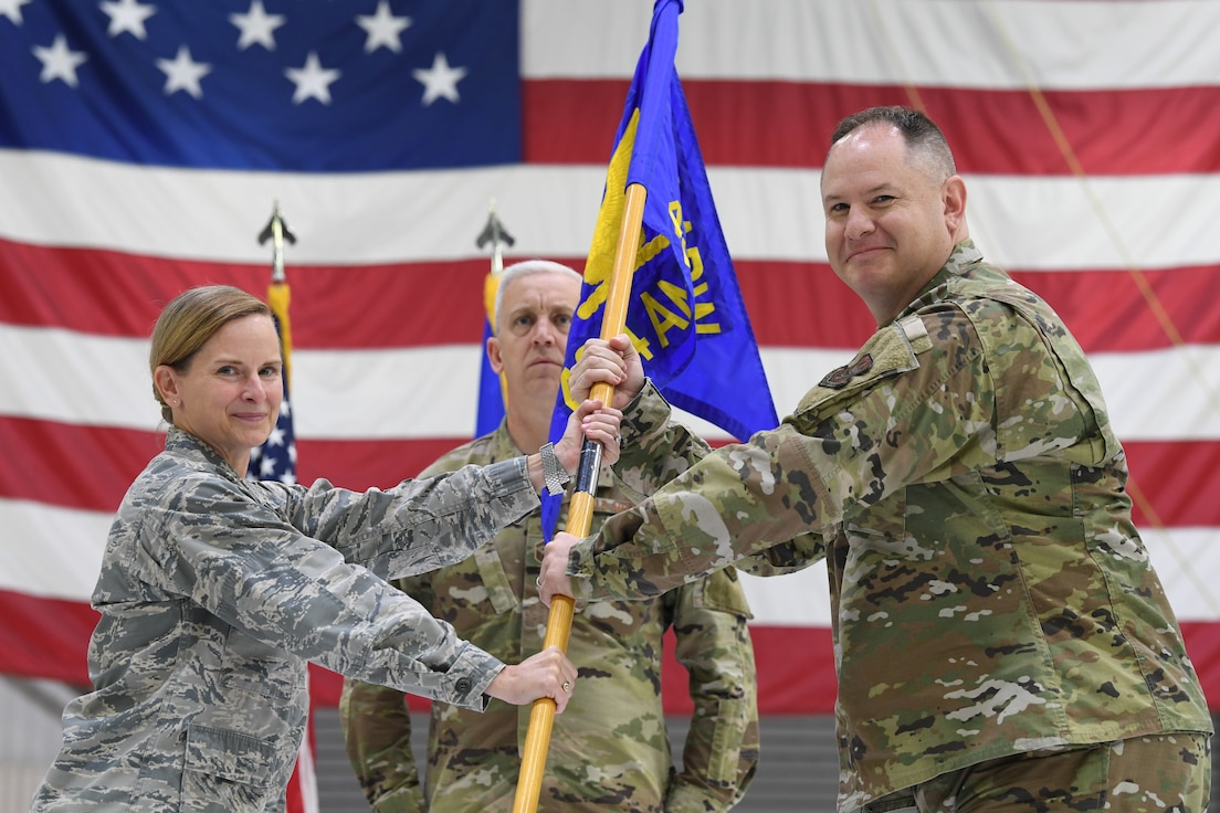 Maj. Matthew Dickerson, 434th Aircraft Maintenance Squadron commander, symbolically accepts a guidon from Col. Arianne Mayberry, 434th Maintenance Group commander, during a change of command ceremony at Grissom Air Reserve Base, Oct. 4, 2020. Dickerson moved into the role after three years as commander of the 434th Maintenance Operations Section.