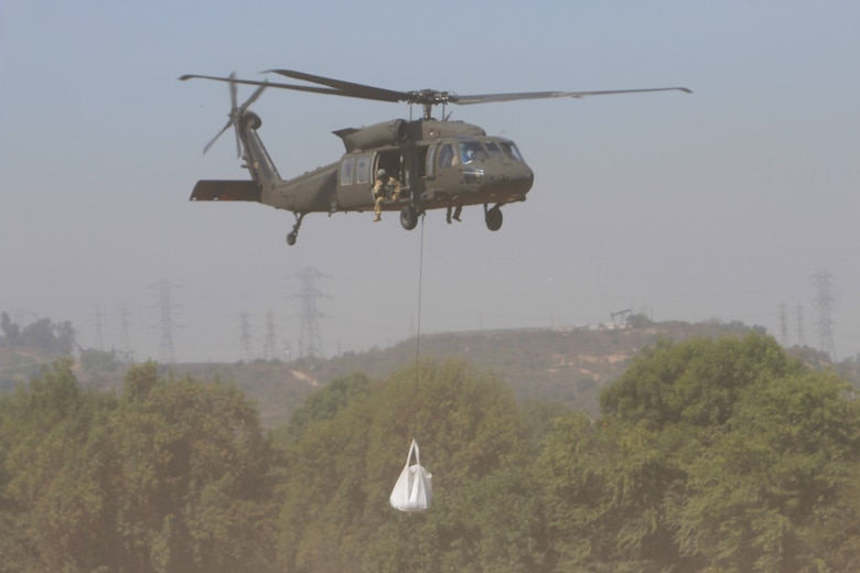 A U.S. Army UH-60M Black Hawk helicopter flown by a crew from the California National Guard's Army Aviation Support Facility #1 at Joint Forces Training Base, Los Alamitos