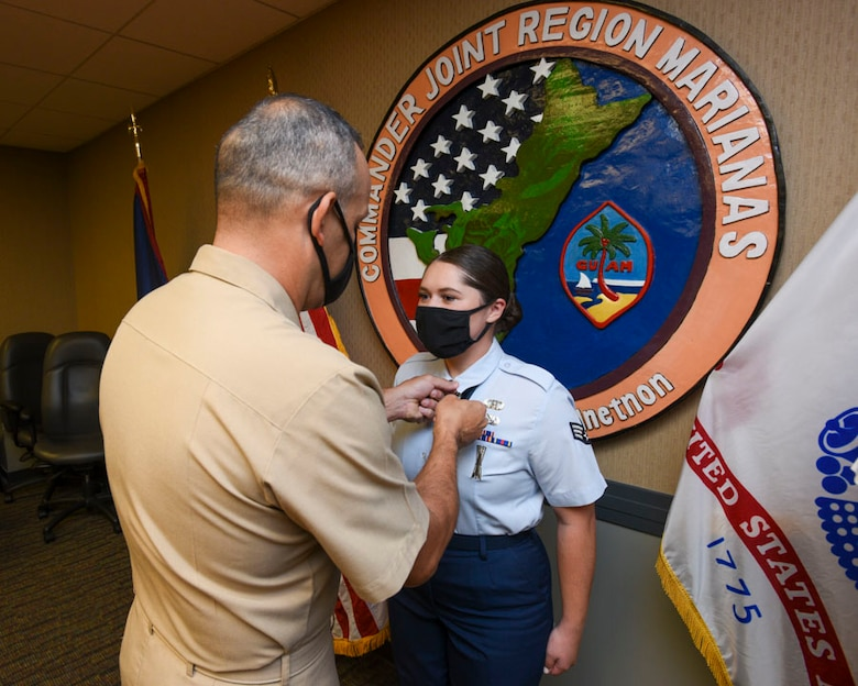 Senior Airman Ell-ie Vonkahle, a precision guided munitions crew chief assigned to the 36th Munitions Squadron, wins the 2019 Joint Region Marianas Junior Service Member of the Year Award on September 25, 2020. The award was personally presented by Rear Admr. John Menoni as a tribute to Vonkahle's outstanding work in the military as well as in the Guam community.