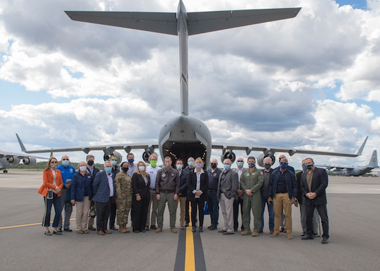 Pittsburgh-area civic leaders pose for a group photo in front of a C-17 Globemaster III assigned to the 911tht Airlift Wing at the Pittsburgh International Airport Air Reserve Station, Pennsylvania, Oct. 1, 2020.
