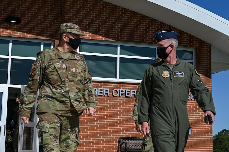U.S. Air Force Lt. Gen. Michael A. Loh, the 13th director of the Air National Guard, walks alongside U.S. Air Force Brig. Gen. Paul Johnson, commander of the 175th Wing, Oct. 3, 2020, at Warfield Air National Guard Base, Middle River, Md. Loh and Johnson just visited the newly built Cyber Operations and Intelligence Surveillance and Reconnaissance building following a cyber mission brief.  (U.S. Air National Guard photo by Senior Airman Sarah M. McClanahan)