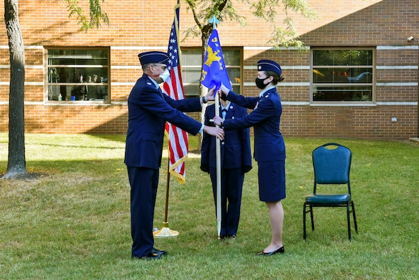 Col. Kenneth M. Lute, commander of the 911th Mission Support Group, passes the guidon to Maj. Corey L. Chance, commander of the 911th Civil Engineering Squadron at the Pittsburgh International Airport Air Reserve Station, Pennsylvania, Oct. 3, 2020.