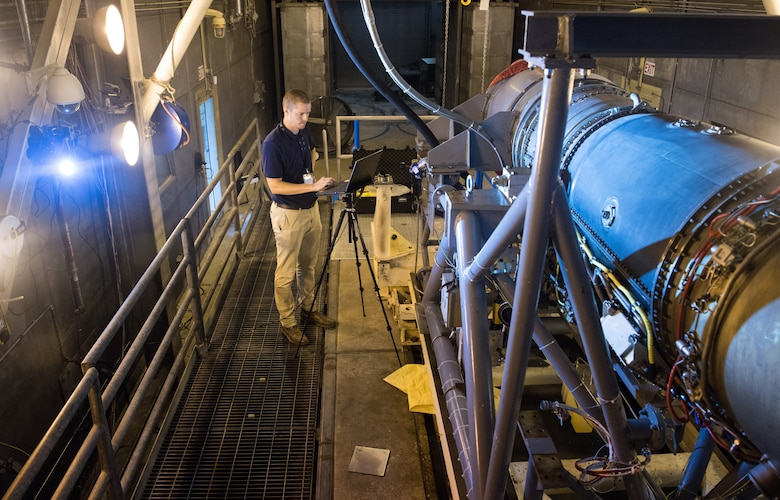 Seth Beaman, a Naval Air Systems Command aeropropulsion test analyst, uses a laptop to check the view of a high-speed camera, Sept. 1, 2020, in the sea-level test cell SL-1 at Arnold Air Force Base, Tenn. The camera, combined with software, allows for the observation and measurement of vibrations. Beaman is studying the potential for its use as an analysis tool for engine testing. (U.S. Air Force photo by Jill Pickett)