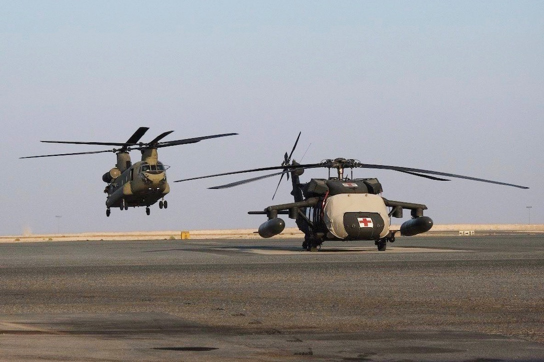 A CH-47 Chinook helicopter, operated by Soldiers with Bravo Company, 2-104th General Support Aviation Battalion, 28th Expeditionary Combat Aviation Brigade takes off from an airfield for a local area orientation flight in the 28th ECAB's area of operations after arriving in the Middle East. These flights ensure 28th ECAB aircrews are properly acclimated and can conduct missions safely during the deployment. (U.S. Army photo by Spc. Jose Brown)