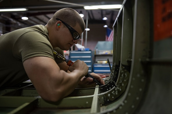 Staff Sgt. Nicholas Novotney uses a 90-degree terry drill on a helicopter door