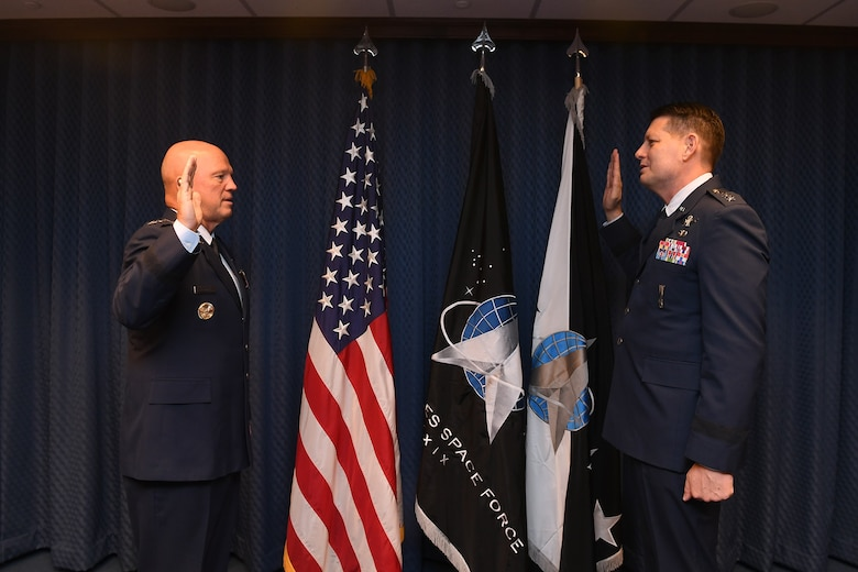 Chief of Space Operations General John Raymond promotes David Thompson to the rank of General during a ceremony in the Pentagon, Washington, D.C., Oct 1, 2020. (Air Force Photo by Andy Morataya)