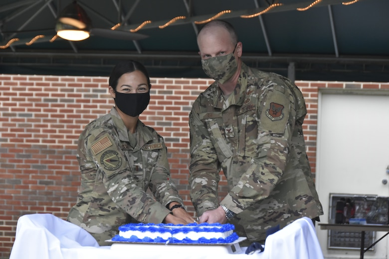 2nd Lt. Riley Vaught, left, and Col. Carl Ise cut the cake during the Air Force Birthday celebration, Sept. 18, 2020, at the Arnold Lakeside Complex on Arnold Air Force Base. It is tradition for the youngest Airman, in this case Vaught, and the oldest to cut the cake together. (U.S. Air Force photo by Bradley Hicks)