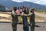 Army Col. Mike Hatfield, the commander of the 100th Missile Defense Brigade, right, and Lt. Col. Michael Lane, the commander of the 117th Space Battalion, unfurl the colors of the 117th Space Battalion during a ceremony at Fort Carson, Colorado, to signify a command relationship change. The 117th is now assigned to the 100th for administrative and operational command and control as part of a larger Colorado Army National Guard realignment.