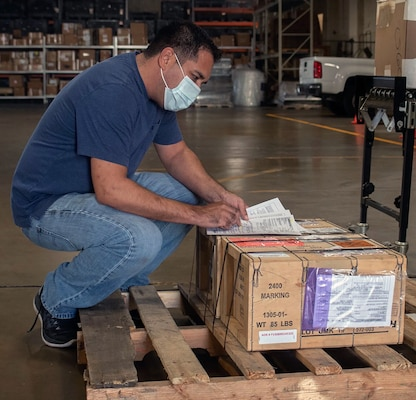 David Howard, a 502nd Centralized Cargo Operations, or CCO, maintainer at Joint Base San Antonio-Randolph, reviews a shipment work order Oct. 5. After the release of a shipment, the CCO tracks packages so the recipient knows when it will arrive.