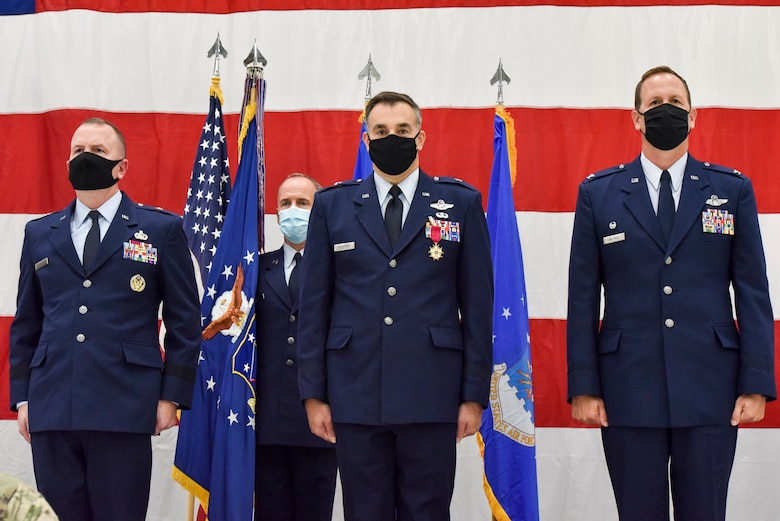Brig. Gen. David May, Wisconsin's deputy adjutant general for Air, Command Chief Master Sergeant James McKay, 115th Fighter Wing Command Chief, Brig. Gen. Erik Peterson, Chief of Staff, Wisconsin Air National Guard and Col. Bart Van Roo, 115th Fighter Wing commander stand-by prior to the passing of the unit flag as part of the official change of command ceremony in an aircraft hangar at the 115th Fighter Wing, Madison, Wis., Oct 3, 2020. Col. Bart Van Roo assumed command of the 115th Fighter Wing from Brig. Gen. Erik Peterson. (U.S. Air National Guard Photo by Tech. Sgt. Mary Greenwood)