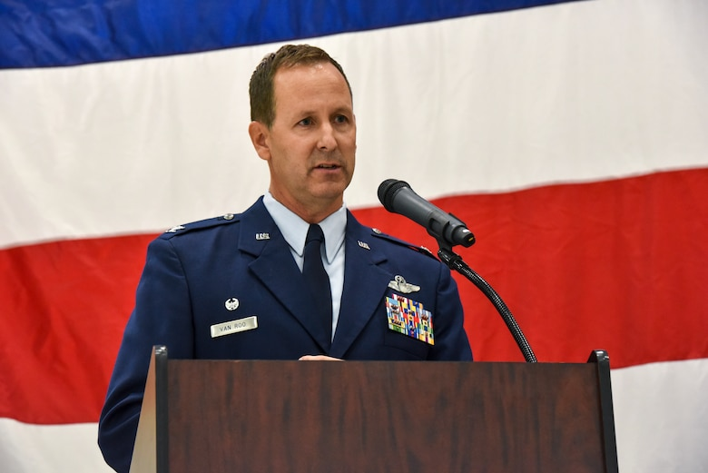 Col. Bart Van Roo, 115th Fighter Wing commander gives his acceptance speech as part of the official change of command ceremony in an aircraft hangar at the 115th Fighter Wing, Madison, Wis., Oct 3, 2020. Col. Bart Van Roo assumed command of the 115th Fighter Wing from Brig. Gen. Erik Peterson. (U.S. Air National Guard Photo by Tech. Sgt. Mary Greenwood)